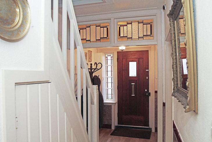 wood banister handrail door hardwood flooring indoors interior design staircase Hal makeover origineel